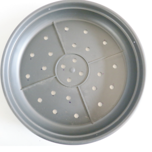 one black plastic saucer pot with holes