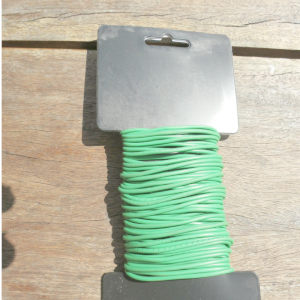 a roll of green flexible rubber garden tie wire