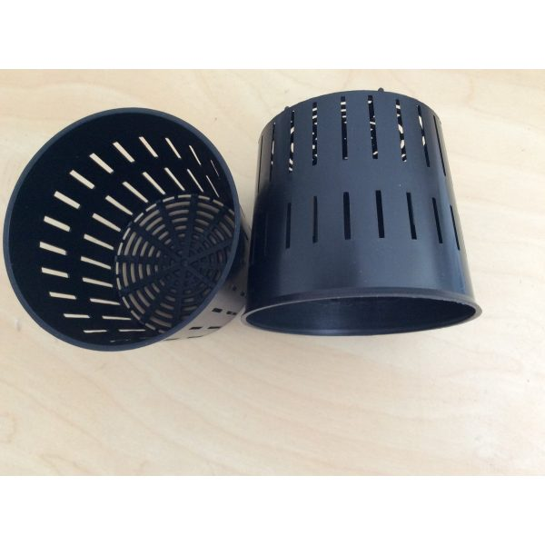 four small black plastic pots with holes on the sides